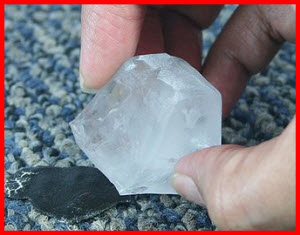Use an ice cube to harden a blob of tar on your carpet before using a butter knife to scrape up the tar.