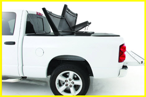 Smittybilt Smart Cover Folding Tonneau Cover is manufactured from 6061 aircraft aluminum, heavy leather like vinyl, a cam based locking system and it even has a cargo net.
