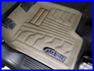 Lund Catch-It Floor Liner Carpeted Model preserves the original OEM carpet look and feel while protecting your feet from mud and liquids.